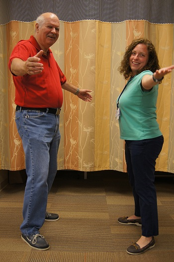 Lockman works on exaggerated movement with physical therapist Andrea Brandson