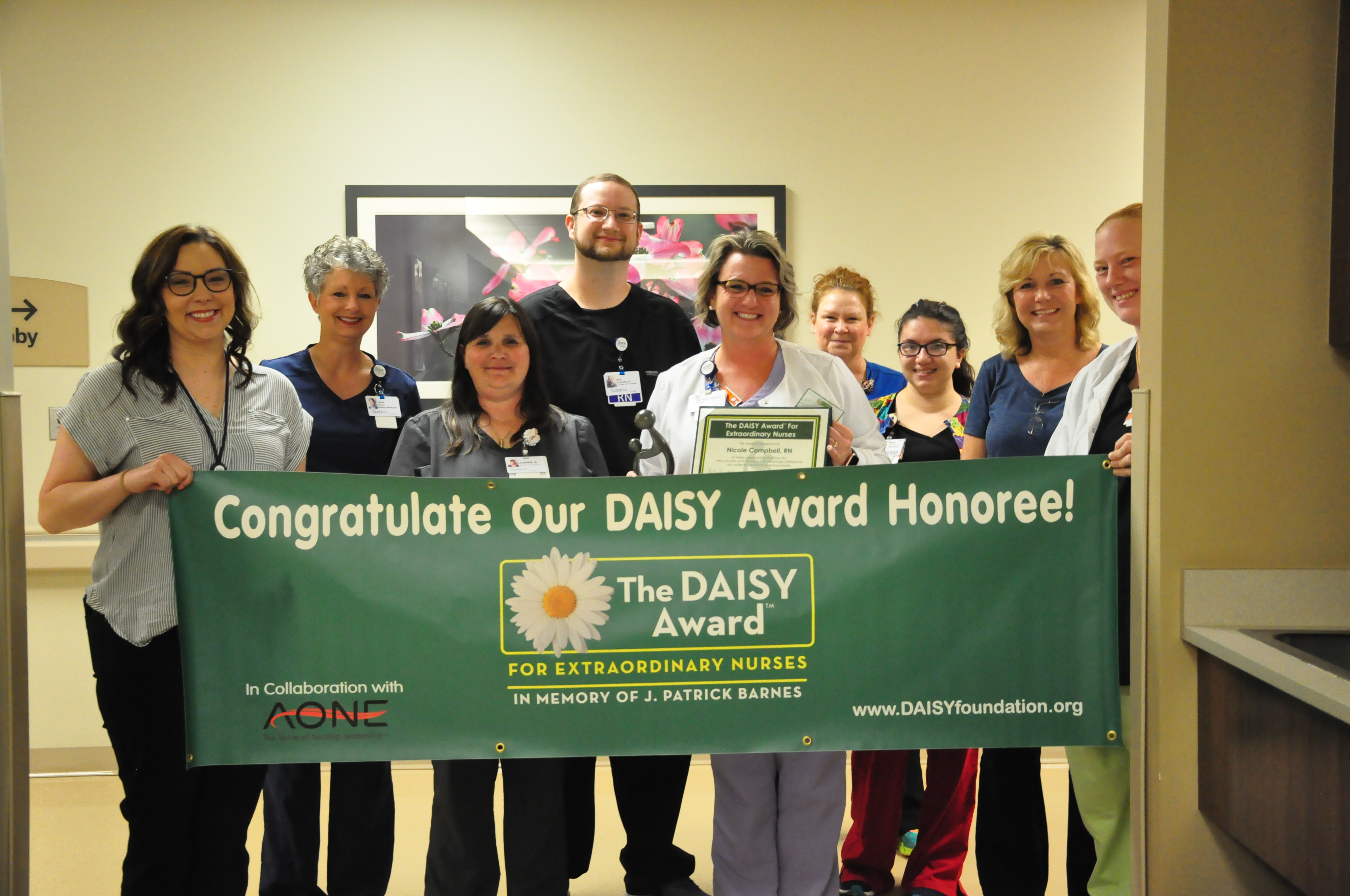 Intensive Care Unit staff and Nusing Managers with Nichole Campbell, RN, DAISY Award Winner