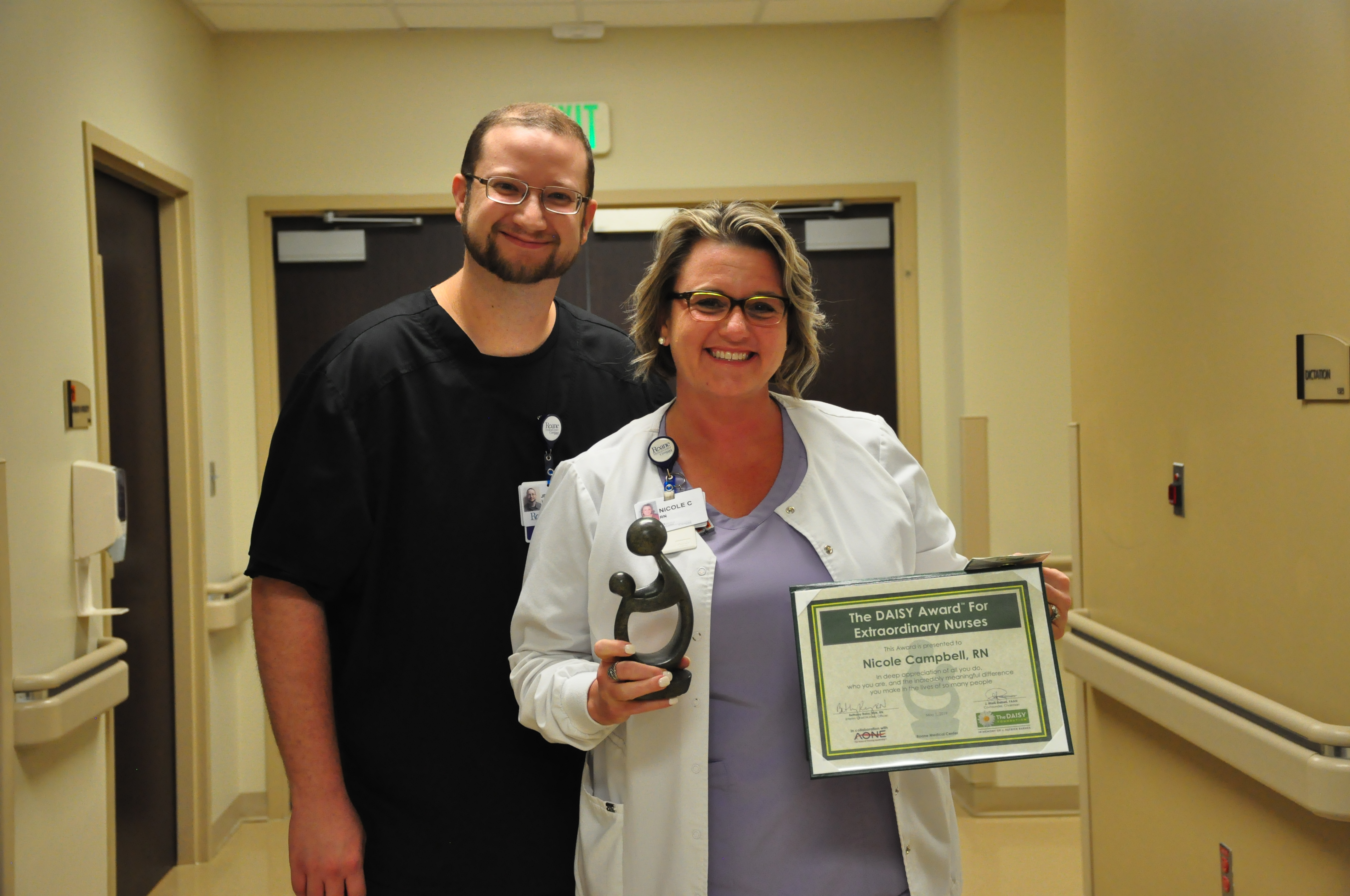 Nicole Campbell, RN, DAISY Award winner with ICU Manager, Jeff Hornbeck